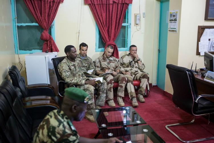 American and French soldiers attend a daily briefing with the Nigerien military commander in charge <br /> of the fight against Boko Haram at a Nigerien military base in Diffa, Niger. Image by Joe Penney. Niger, 2018.