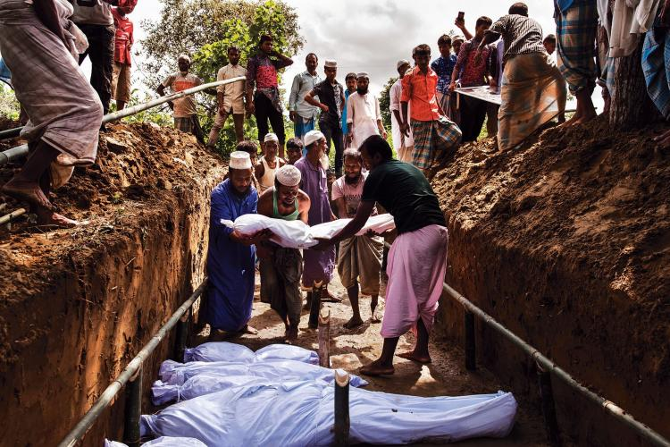 A mass grave for a group of Rohingya who drowned while tying to escape Myanmar. Image by Patrick Brown/Panos Pictures/UNICEF. Bangladesh, 2017.