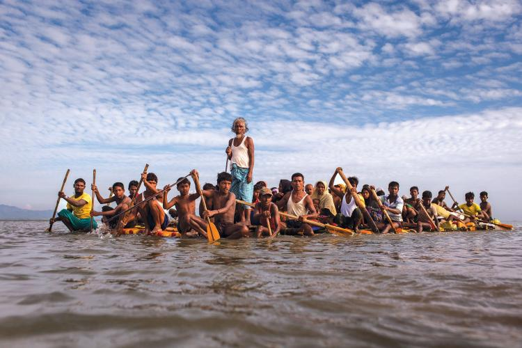 Rohingya fleeing across the Naf River to Bangladesh. The crisis made global headlines in 2015 when boats packed with starving Rohingya were stranded at sea. For weeks, no country would accept them. Image by Patrick Brown/Panos Pictures/UNICEF. Bandladesh, 2017.