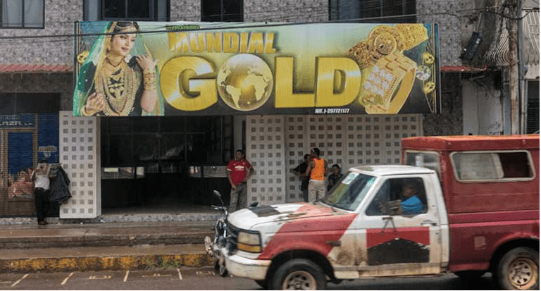 Shops that buy and sell gold dominate the town of El Callao, a miners' enclave. Small-scale miners rarely receive the full value of the gold they mine. Image by Bram Ebus. Venezuela, 2017.