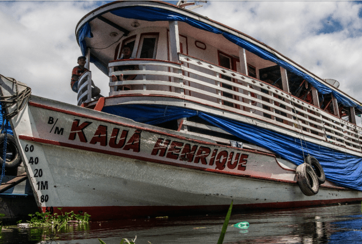 An Amazon river boat. Such vessels have long been a chief means of travel for locals and for tourists. But new roads and railways are steadily being built across the Brazilian Amazon, bringing large scale settlement, agribusiness and mining. Image by Matheus Manfredini. Brazil, 2019.