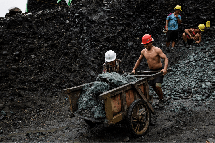 A team of freelance miners cart away stones from a jade mine in Hpakant on July 17. Image by Hkun Lat. Myanmar, 2020.