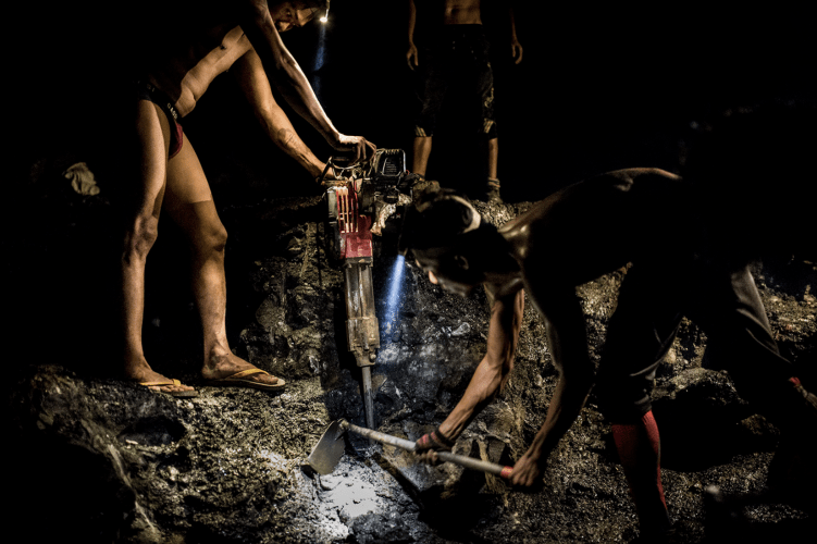 Miners use jackhammers and headlamps to search for jade at night in Hpakant on Aug. 15, 2018. Image by Hkun Lat. Myanmar, 2018.