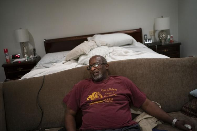Mike Bishop sits in his bedroom. Image by Wong Maye-E/AP Photo. United States, 2020.