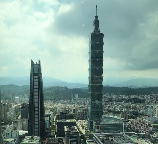 Taipei's best-known landmark is this tall building (right), called Taipei 101. It was the world's tallest building from 2004 to 2010. Image by Melissa McCart. Taiwan, 2018.