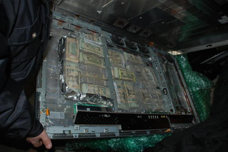 A photo provided by the Phelps County Sheriff's Department shows a flatscreen TV stuffed with cash that the department seized. Image released by Phelps County Sheriff's Department.