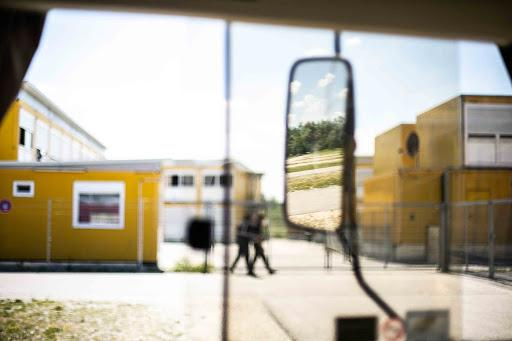 Security guards circle the Ingoldstadt ANKER centers in Bavaria, Germany. Guards are on site 24/7. Image by Angelica Ekeke. Germany, 2019.