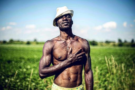 Israel, a 30-year-old Nigerian refugee poses for a portrait in the countryside of Bavaria, Germany. Image by Angelica Ekeke. Germany, 2019.