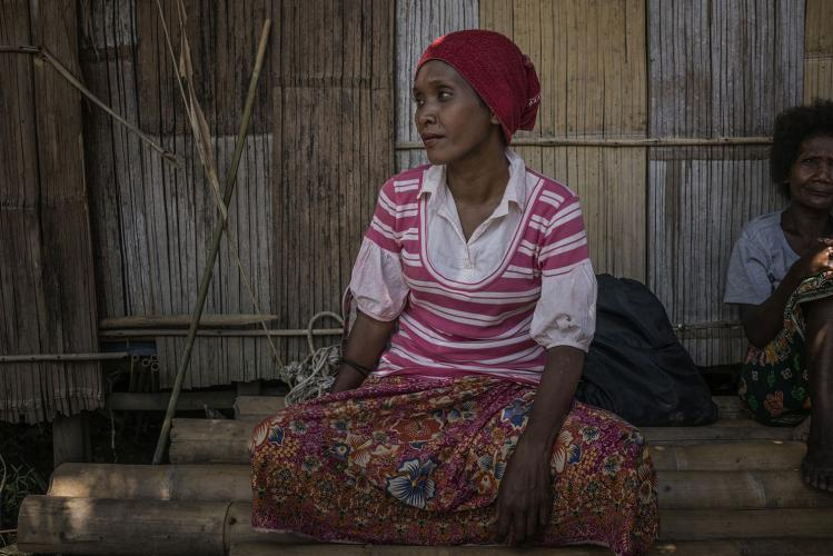 Nira was hospitalized for two months before recovering from the mysterious illness that struck this community of Batek in Kuala Koh. Symptoms included swollen throats and high fever, blurred vision with bloodshot eyes, and head and body aches. The stricken couldn't eat or drink. Image by James Whitlow Delano. Malaysia, 2019.