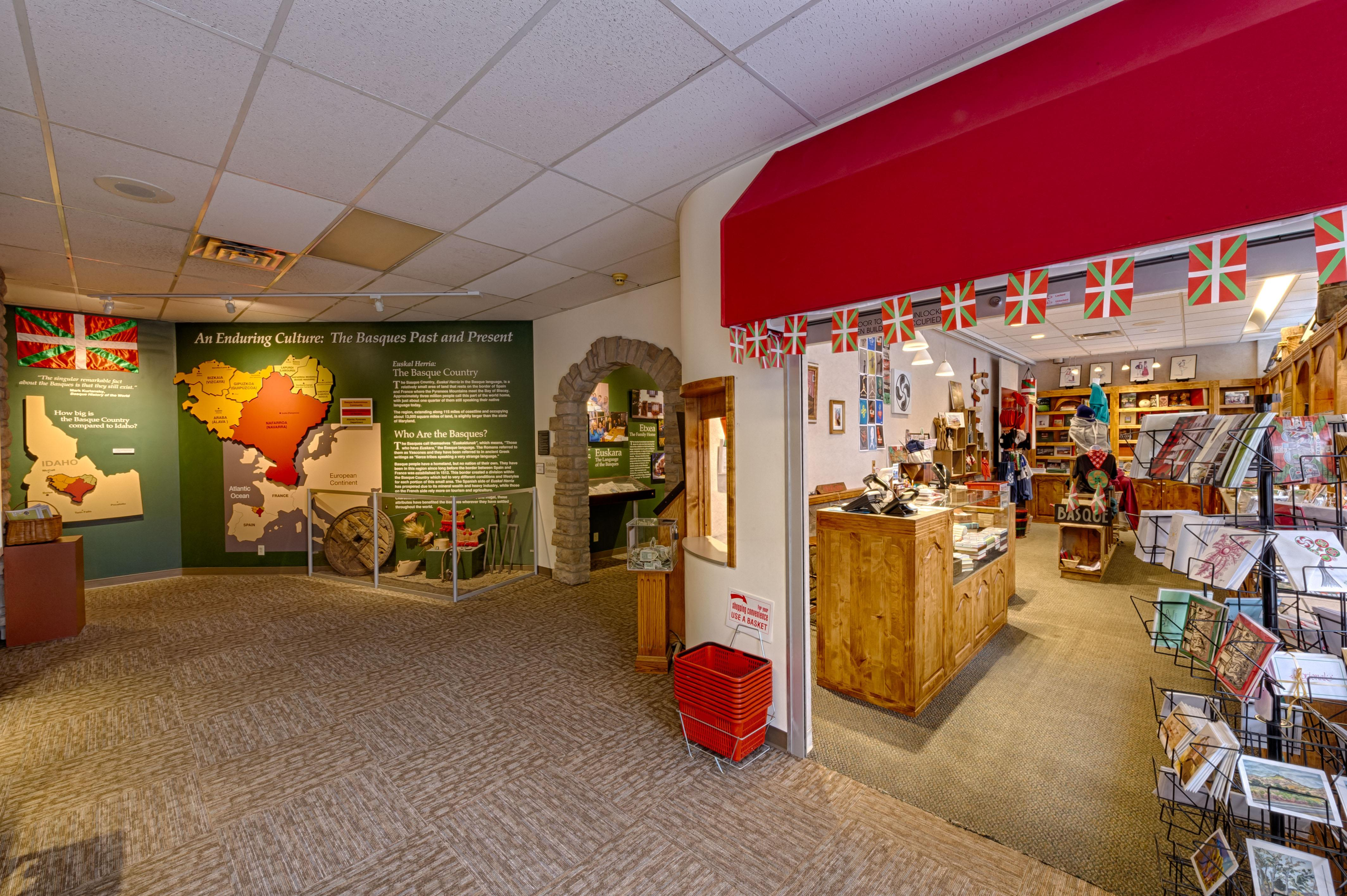 Inside of the Boise Basque Museum and Cultural Center. Pictured are an exhibit about Basque history and culture and a gift shop.
