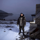 Karl Michelin poses for a portrait at the water's edge of Lake Melville in Rigolet wearing a dickie made of seal skin from a seal he hunted from the bay on Nov. 13, 2019. Image by Michael G. Seamans. Canada, 2019.<br />
